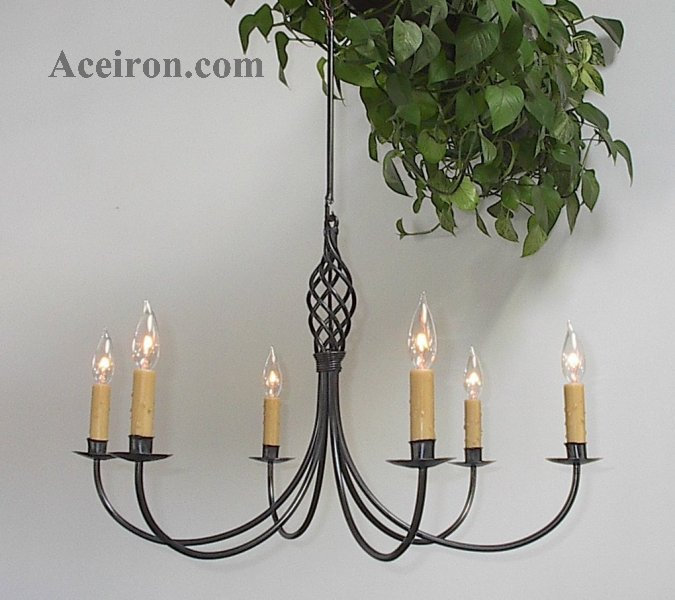 lighting chandeliers chandelier charm what black rod troy world a table old wrought over is iron cast frame